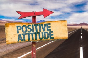 Positive Attitude sign with road background